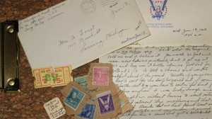 Letter along with somr stamps and other items sent home